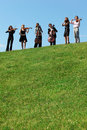Six Musicians Play Violins Against Sky Royalty Free Stock Images - 10504619