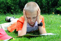 The Boy Reads Royalty Free Stock Photography - 10511497