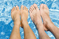 Feet Over The Swimming Pool Stock Image - 10577811