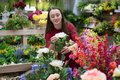 Beautiful Woman Buying Flowers At Flower Shop. Happy Women Moments Royalty Free Stock Photos - 105830008