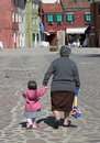 A Young Child And Her Grandmother Walk Along The Streets Of Bura Royalty Free Stock Image - 1065066