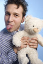 Young Man With A Teddy Royalty Free Stock Photography - 10625297