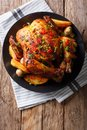Baked Whole Chicken With Mushrooms And Potatoes Close-up On A Pl Royalty Free Stock Photos - 106262188