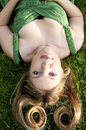 Sexy Young Blond Woman Laying On Green Grass Royalty Free Stock Photo - 10651905