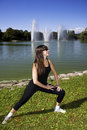 Woman Stretching By The Lake Stock Images - 10652424