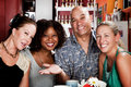 Man With Three Pretty Women In Coffee House Royalty Free Stock Images - 10653949