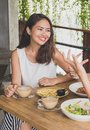 Beautiful Young Woman Smiling While Having Lunch With Friends Royalty Free Stock Photography - 106502387
