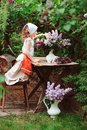 Kid Girl At Garden Tea Party In Spring Day With Bouquet Of Lilacs Syringa Stock Photo - 106662860