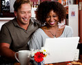Mixed Race Couple In Coffee House With Laptop Comp Stock Images - 10696444