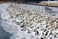 Rocks Covered With Snow In Cold River After Winter Storm Riverside In Detroit Royalty Free Stock Images - 107932059