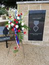 Red, White, And Blue Bouquet Decorates Purple Heart Memorial Royalty Free Stock Photography - 108114677