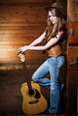 Beautiful Caucasian Cowgirl With Guitar Royalty Free Stock Images - 10820279