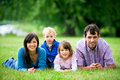 Young Family In Park Royalty Free Stock Photography - 10857927