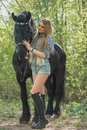 Beautiful Girl Stroking Horse Outside Royalty Free Stock Images - 108676229