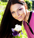 Woman Smiling Outdoors With Some Flowers Royalty Free Stock Photo - 10899085