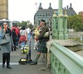 A Scottish Bagpipe Player On A Busy Westminster Bridge In London Stock Photos - 108950443