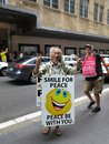 Happy Asian Man In Sandwich-board And Guy Photobombing Royalty Free Stock Image - 109277556