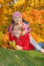 Mum With A Daughter In Autumn Park Stock Photo - 10961290