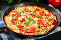 Frittata Made Of Eggs, Sausage Chorizo, Red Pepper, Green Pepper, Tomatoes, Cheese And Chili In A Pan On Wooden Table Royalty Free Stock Images - 109780309