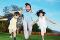 Happy Family Running Outdoor, On Beautiful Garden Stock Photography - 10991842
