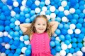 Kids Play In Ball Pit. Child Playing In Balls Pool Royalty Free Stock Photos - 109998008