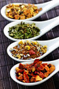 Assorted Herbal Wellness Dry Tea In Spoons Royalty Free Stock Photography - 11010747