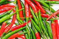Red And Green Chili Peppers Royalty Free Stock Photos - 11019878