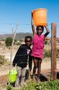 Girls With Water Buckets Royalty Free Stock Image - 110169286