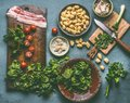 Cooking Preparation Of Potato Gnocchi Meal With Spinach,tomatoes And Bacon On Rustic Table Royalty Free Stock Image - 110739846