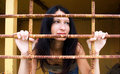Young Woman Behind A Lattice Stock Photo - 11093280