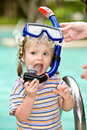 Baby In Blue Diver Mask Leaves Pool. Stock Photography - 11209462