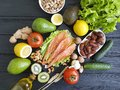 Salmon Fish, Avocado Organic Green Dietary On A Wooden Healthy Food Assorted Royalty Free Stock Photos - 112051168