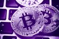 Bitcoin Cryptocurrency Coins On Laptop Keyboard. Close Up Ultraviolet Toned Stock Photo - 112586650