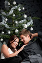 Extravagant Couple In Front Of Christmas Tree Royalty Free Stock Photos - 11269338