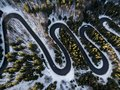 Winding Road From High Mountain Pass, In Winter Time. Aerial View By Drone Royalty Free Stock Photos - 112705958