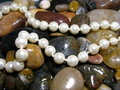 Pearls Over River Rocks Royalty Free Stock Photo - 11310005