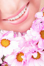 Smile Of Woman With Flowers Stock Photography - 11358572