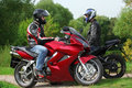 Two Motorcyclists Standing On Country Road Stock Image - 11411601