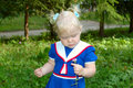 Little Girl In Sailor Blue Dress Walk In The Park. Royalty Free Stock Photo - 11415745