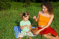 Little Girl And Young Women In Hand Sweet Cherries Royalty Free Stock Photography - 11436157