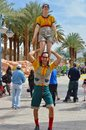 Street Acrobats Smiling, Dressed In Funny Clothes Stock Image - 114991221
