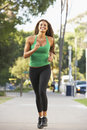 Young Woman Jogging On Street Stock Photography - 11502892