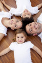 Family Lying On Floor With Heads Together Royalty Free Stock Images - 11541299