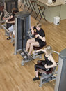 Boy And A Girl Using Excercise Machines Stock Image - 11553201