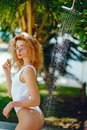 Blonde Girl Taking A Shower Royalty Free Stock Photography - 115699887