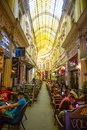 Bucharest, Rumania - 28.04.2018: People In Passage Macca Villacrosse, Covered Yellow Glass Passage In Bucharest Royalty Free Stock Images - 116183179
