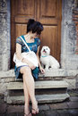 Chinese Girl With A Dog Royalty Free Stock Images - 11697919