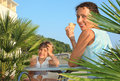 Girl And Young Woman Eat Ice-cream Near Palm Trees Stock Photos - 11720203