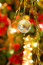 Christmas Disco Ball Over Defocused Tree Stock Photography - 11737442
