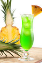 Green Tropical Cocktail With Pineapple Slice Royalty Free Stock Photography - 11754237